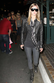 Nicky looks touch-chic in this all black ensemble. She topped off the edgy look with an Alexander McQueen skull scarf.