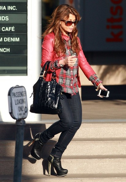 Paula Abdul chose a bright red leather jacket to pair over her red plaid shirt while out in LA.