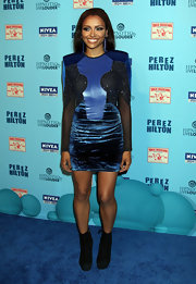 Katerina Graham teamed her futuristic blue dress with black suede ankle boots.