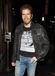 Perez Hilton went for a macho look with a black leather jacket and jeans during a Jonas Brothers concert.