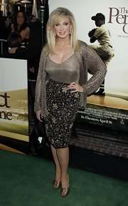 Morgan Fairchild wore an ultra-chic shimmery ensemble to the premiere of 'The Perfect Game,' consisting of a chainmail jacket, a gold top, and an embroidered pencil skirt.