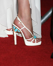 Milla donned a pair of strappy gemstone encrusted sandals, which looked great when paired with her floor-length white dress.