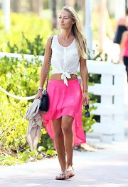 Petra Benova looked ready for a day in the sun when she sported this hot pink mini skirt with a fish tail hem.