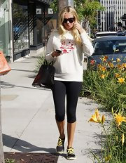 Petra Ecclestone kept her daytime look casual and comfy with a pair of black leggings.