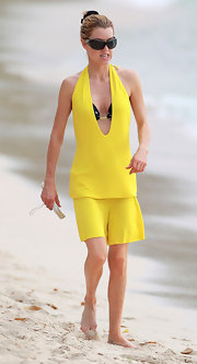 Julie looked sporty but still stylish in a bright canary yellow romper over her bikini while on the beach in Barbados.