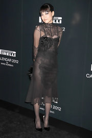 Rinko Kikuchi wore a sheer lace LBD with a high-neck for the Pirelli Gala in NYC.