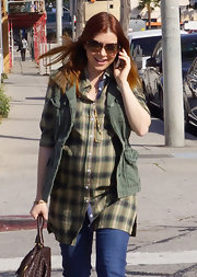 A pregnant Alyson Hannigan layered her look with an olive cargo vest.