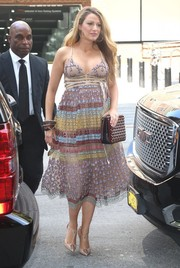 Blake Lively finished off her flawless look with a studded shoulder bag, also by Christian Louboutin.