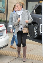 Cat Deeley styled her look with a classic beige leather bag.