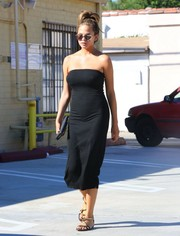 Chrissy Teigen styled her dress with chic Giuseppe Zanotti serpent sandals.