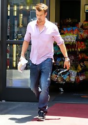 Josh Duhamel stuck to a casual preppy look with this lavender button down.