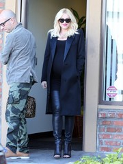 Gwen Stefani looked fierce, as always, in black open-toe booties, leather skinnies, and a satin-lapel coat while visiting an acupuncture studio.