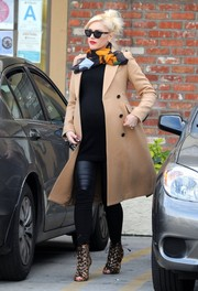 Gwen Stefani showed off her flawless style with this camel-colored wool coat, patterened scarf, and leather skinnies combo while visiting an acupuncture studio.