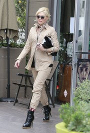 Gwen Stefani rocked the safari look in a tan utility button-down and matching pants during a visit to the nail salon.