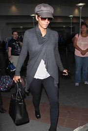 Halle Berry traveled in style in this long gray cardigan.