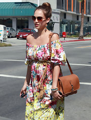 Jessica Alba was a blooming beauty while out in Beverly Hills. The starlet pinned her hair up in a high bun for a casual spin on an elegant hairstyle.