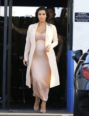 Kim Kardashian showed off her sharp maternity style with this cream-colored Maison Margiela double-breasted silk dress that she wore as a coat while visiting a production office.