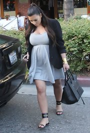 Kim Kardashian played it safe but still looked chic in flat ankle-cuff sandals by Gucci.