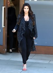 Kim Kardashian dressed up her black top and leggings with this printed, flowing cardigan.