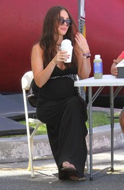 Megan Fox was spotted at the Farmers Market wearing a long black maternity dress.