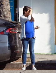 Mila Kunis layered a striped cardigan over an electric-blue shirt for a day out in Studio City.