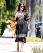Rachel Bilson went shopping looking cute in a peasant maternity dress with colorful stripe accents and a floral-embroidered yoke.