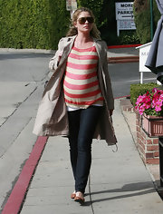 Rebecca wears a classic trench over a striped tee while out in West Hollywood.