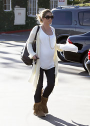 Rebecca Gayheart goes for comfort while running around in LA. She is sporting a new pair of Ugg boots featuring fringe, hopefully this trend does not stick around.