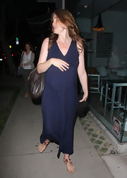 Saffron Burrows finished off her casual look with cute bow-embellished thong sandals.