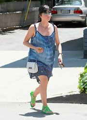 Selma Blair teamed her eclectic day wear with a white leather chain strap purse.