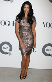 Camila Alves accented her shimmery Oday Shakar dress with pewter metallic Wagner platforms.