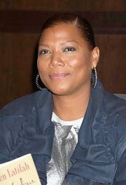Queen Latifah showed off her diamond hoop earrings while signing copies of her new book release.