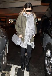 Rachel was swathed in a soft silky gray patterned scarf at the airport.