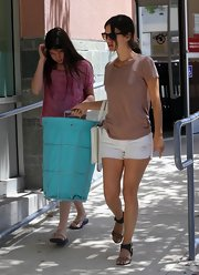 Rachel Bilson teamed her tee/shorts combo with a pair of ShoeMint leopard-print sandals with crisscross ankle straps.