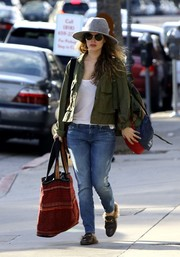 Rachel Bilson went shopping in Studio City wearing a green military jacket over a white shirt.