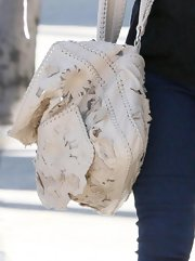 Actress Rachel Bilson and contributing editor to InStyle Magazine, showed off her fashion sense while out in Hollywood. She carried a coveted Valentino bag, which has flowered embroidery.