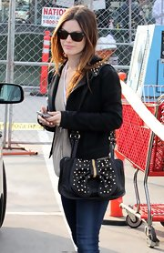 "Rachel loves her studded leather bags and this ""Studded bow bag"", is definitely her bag of the moment."