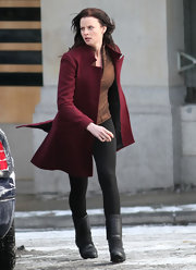 Rachel Nichols was spotted on set in a burgundy coat and black flat boots.