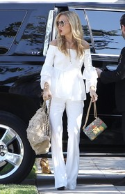 Rachel Zoe looked pristine in her white-on-white flare pants and off-the-shoulder top combo.