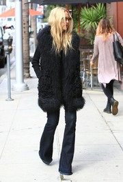 Rachel Zoe got majorly hippie in a black fur vest and flare jeans for a day of shopping.