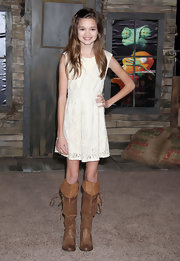 Ciara Bravo toughened up her girly dress with a pair of tan knee-high boots.