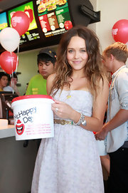 Rebecca Breeds topped off her sweet ensemble with a heart charm bracelet.