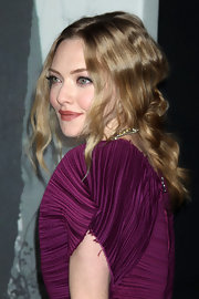 Amanda Seyfried pulled her hair up in a messy updo that draped down the back of her neck.