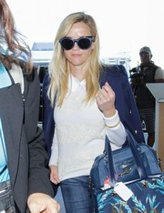 Reese Witherspoon was spotted at LAX rocking a pair of two-tone cateye shades by Self-Portrait x Le Specs.