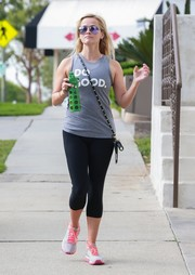 Reese Witherspoon teamed a Cotopaxi 'Do Good' tank top with cropped leggings for her workout.