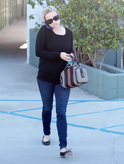 Reese Witherspoon topped off her casual look with embellished ballet flats.