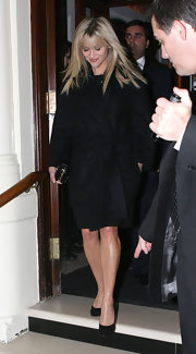 Reese Witherspoon kept things simply chic in a black wool wrap coat and matching pumps.