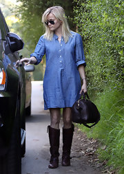 Reese Witherspoon looked polished while leaving a friends house in a pair of flat leather oxblood boots.