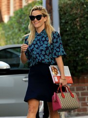 Reese Witherspoon was retro-glam wearing these oversized cateye sunnies by Self-Portrait x Le Specs while leaving her Beverly Hills office.