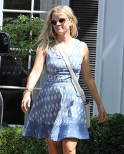 Reese Witherspoon wore a cute blue and white printed mini by Joie for her office attire.